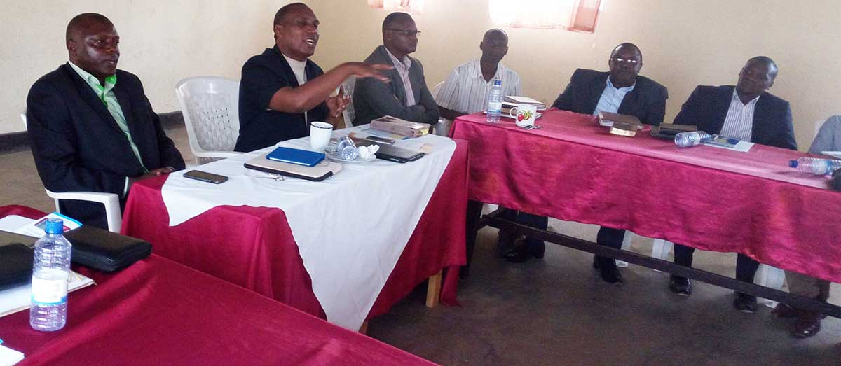 At head table, left to right: Antoine Samvura, FPH coordinator. David Bucura, legal rep. & Rev. Aaron Mupenda, vice legal rep.